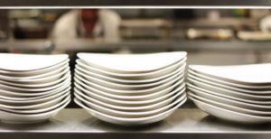 image of stacked clean plates in restaurant